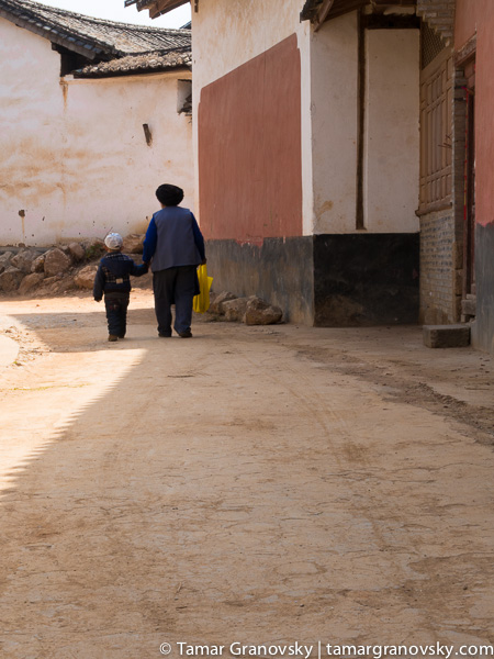 Grandmother and Grandchild out for a Stroll, Shaxi, Yunnan, China