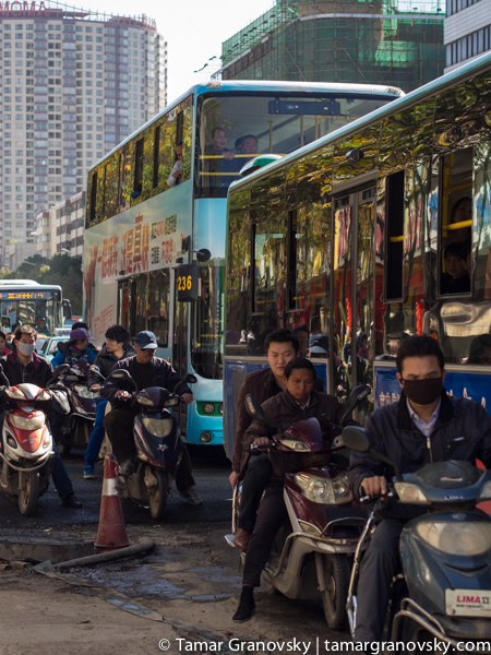 Exception to the Rule (most people who drive motorbikes in Kunming still do not wear masks - at least not in early 2014)